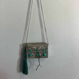 Silver crossbody with turquoise and tassel accents